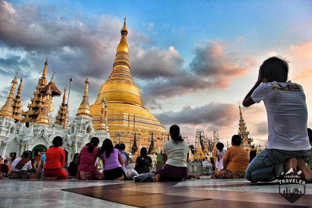Locals praying infront of Shwedagon Pagoda in Yangon in Myanmar. #Myanmar,#Burma,#Yangon,#Shwedagon_Pagoda