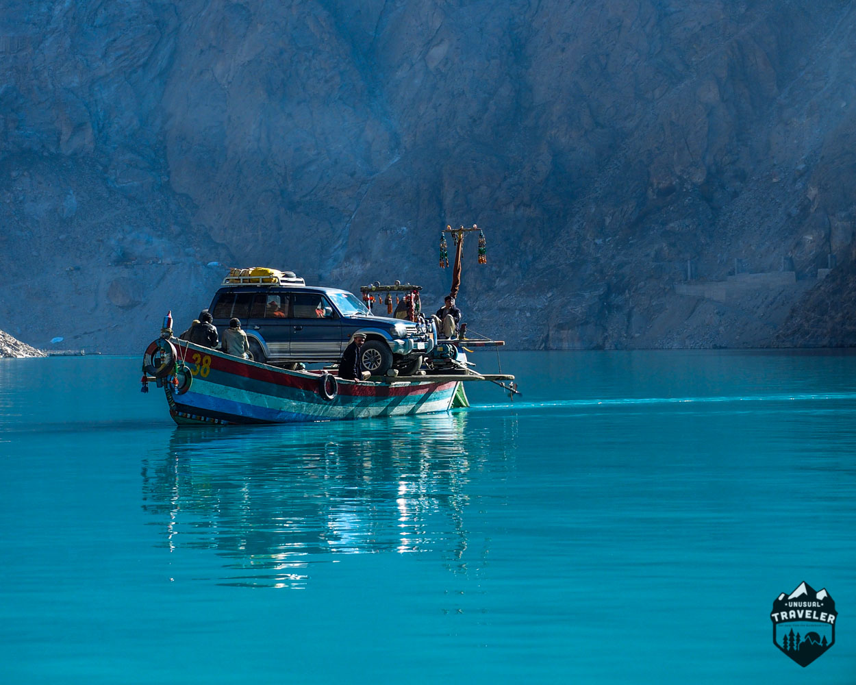 Boat crossing Attabad Lake in Hunza, Pakistan between the Karakoram range