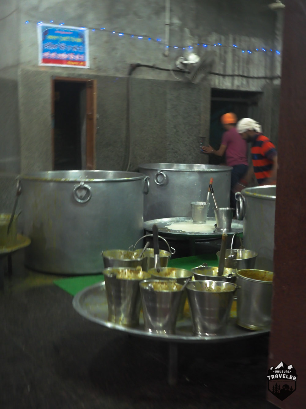 the people working in the kitchen at the golden temple