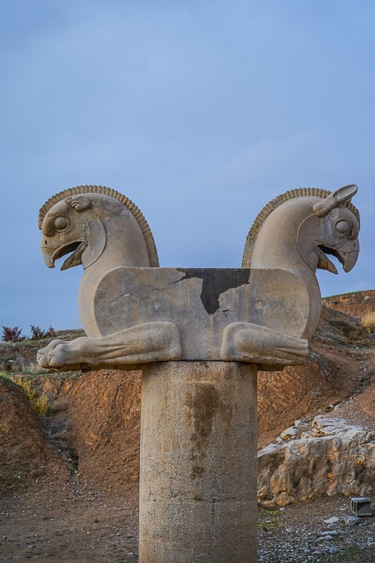 Huma bird Griffin-like column capital statuary in persepolis iran