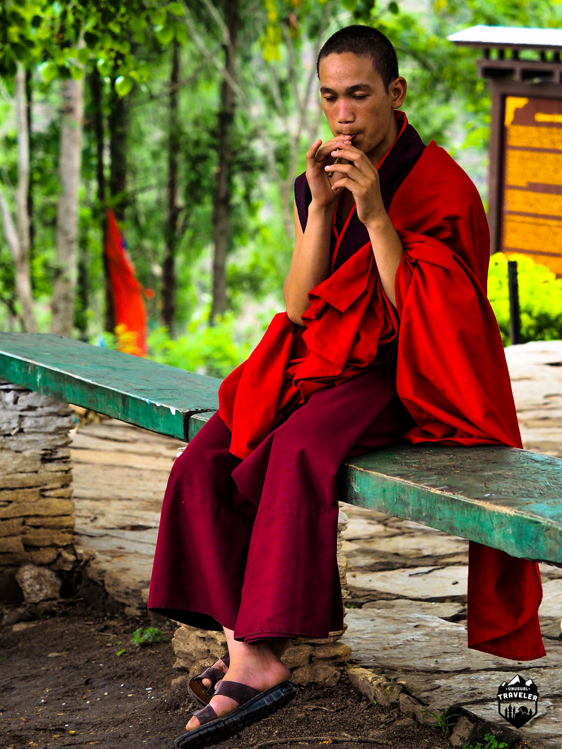 A Bhutanese monk flying hes homemade flute in a small monastery.