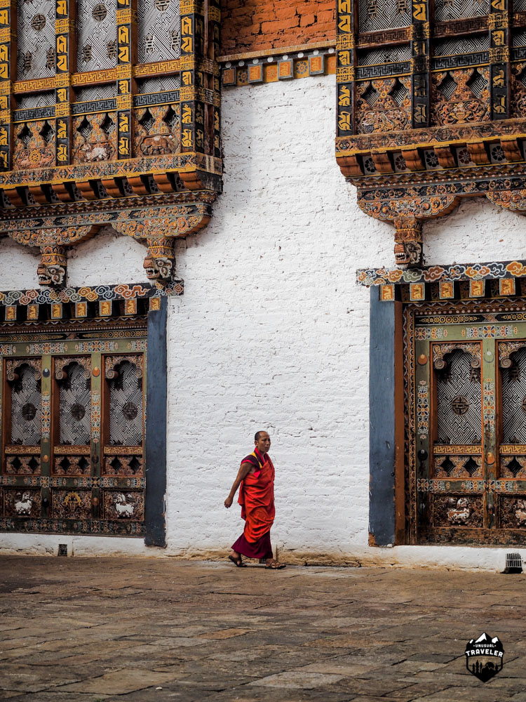 A residential monk walking across the third courtyard