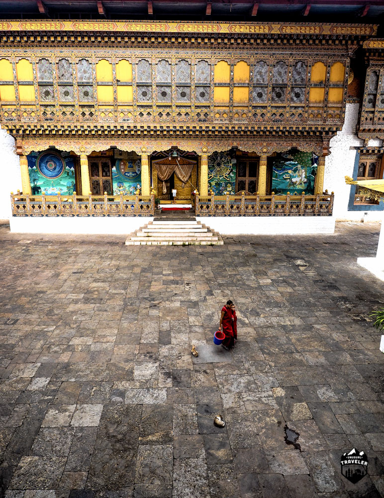 Two Monks walks across the third courtyard, the temple with the national treasures are located on the right side of the courtyard.