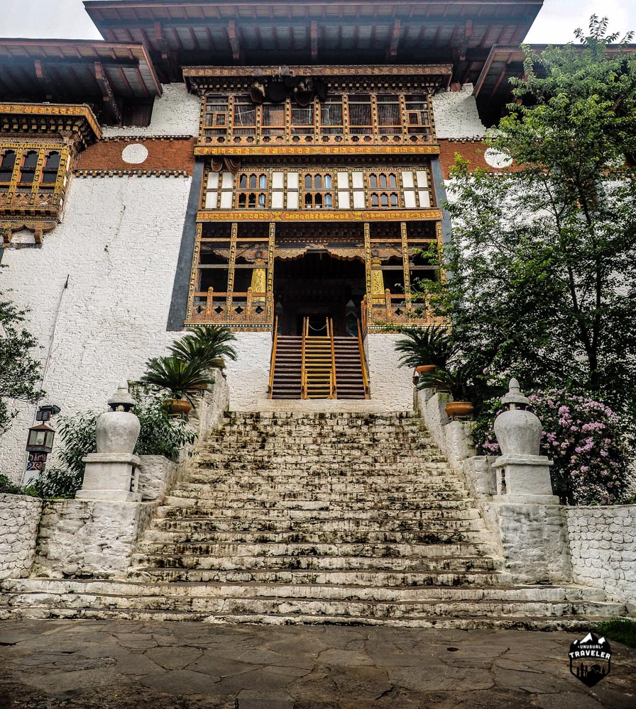 The main entrance to Punakha Dzong, it might not seem steep, but it is. NB, Notice the Bie hives underneath the roof.