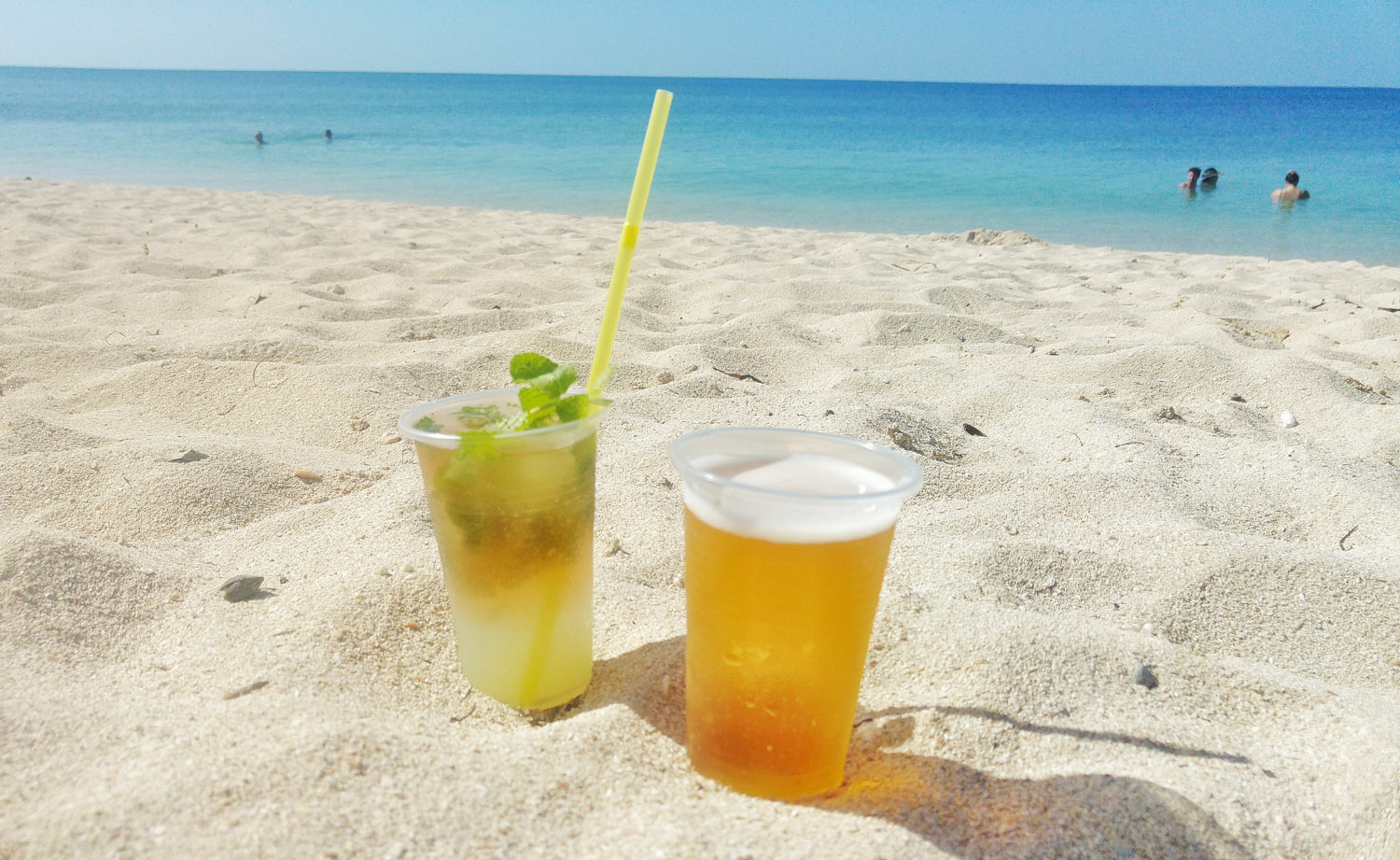 Enjoying a cold beer and mojito on the beach for 1 CUC.