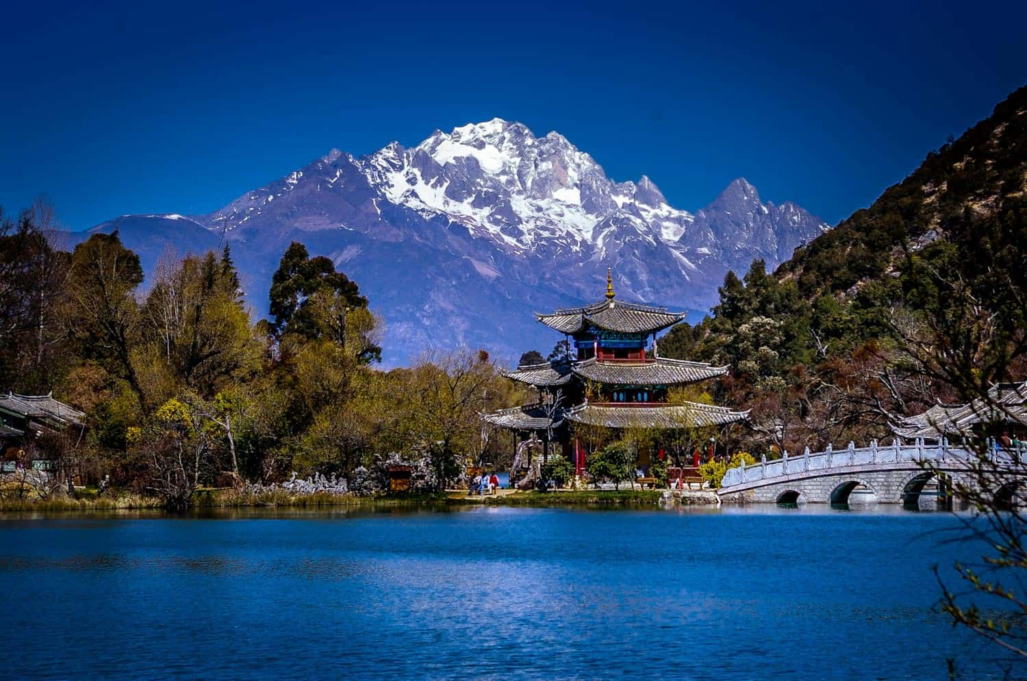 Jade Spring Park (Black Dragon Pool Park) with theJade Dragon Snow Mountain in the back