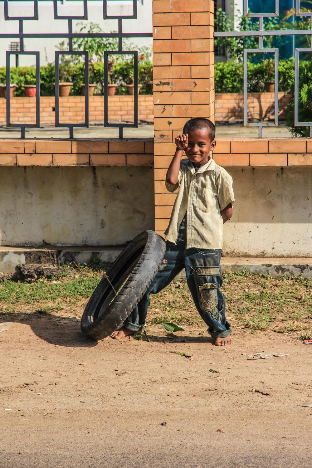 A local kid posing for photo, he wanted to give me the wheel as a gift