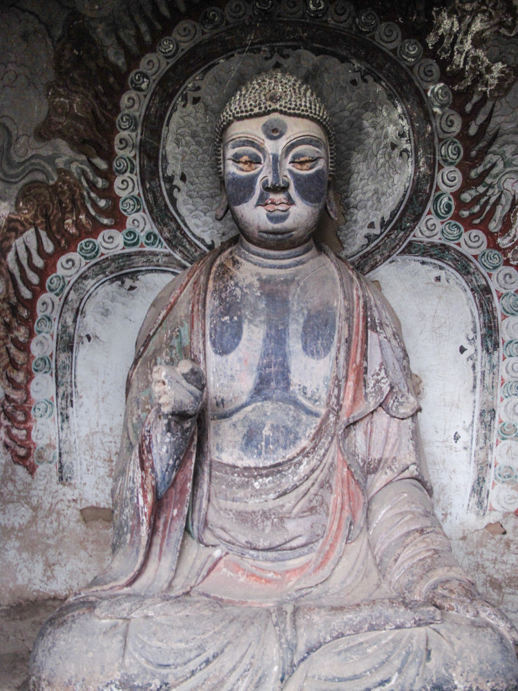 One of many Bhuddist statues. still with orginal paint