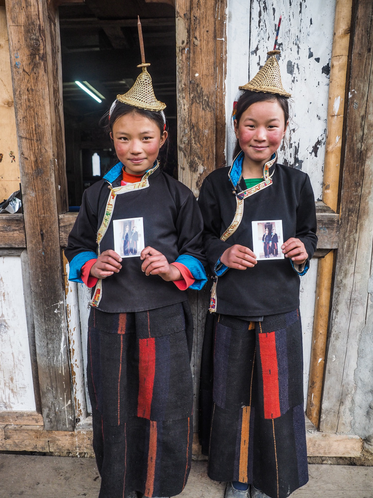 Two young Layap´s posing with their Polaroid photo.