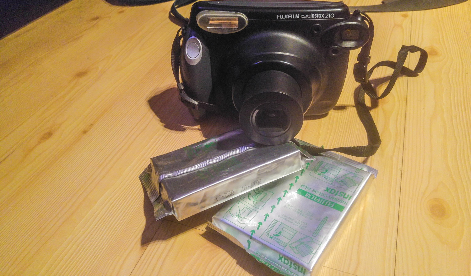 My Polaroid camera with 2 packs of film.