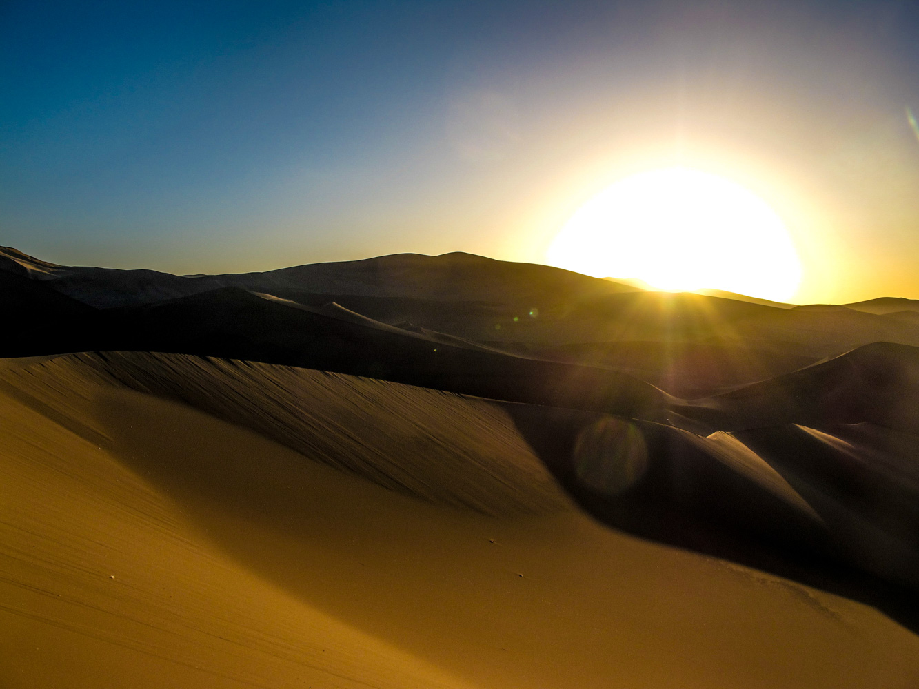 Sunset in the desert outside of Dunhuang