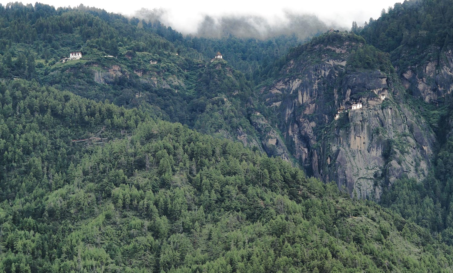 The Tiger Nest up there to the right as seen from the road in Bhutan