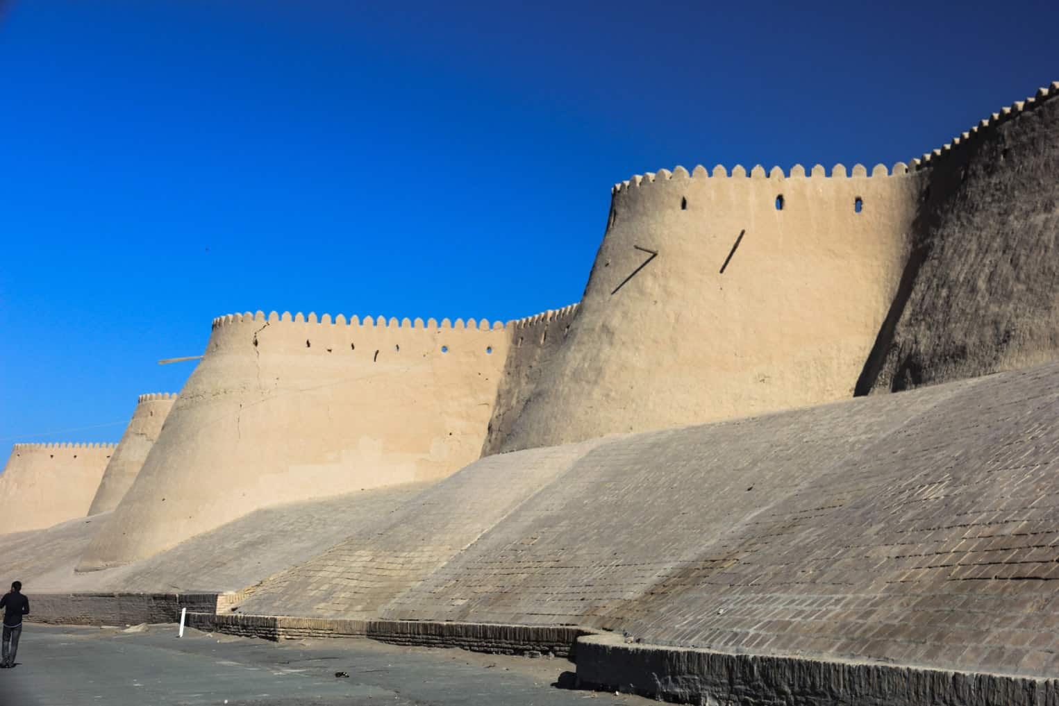 Part of the 10 meter tall wall surrunding old town Khiva travel guide