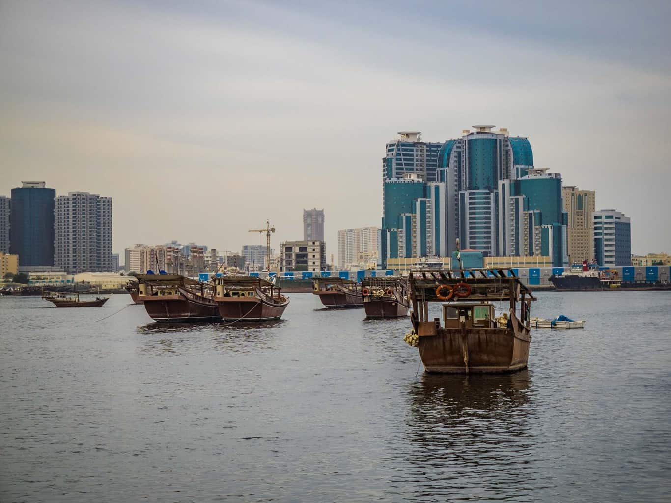 Traditional Fishing boats infront the the modern skyline in Ajman