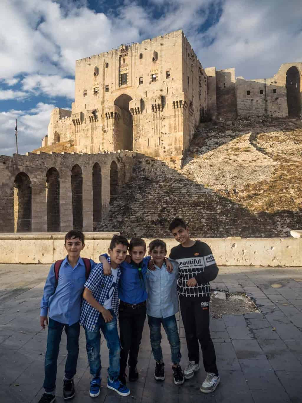 young Syrian kids in front of Aleppo Citadel 2017