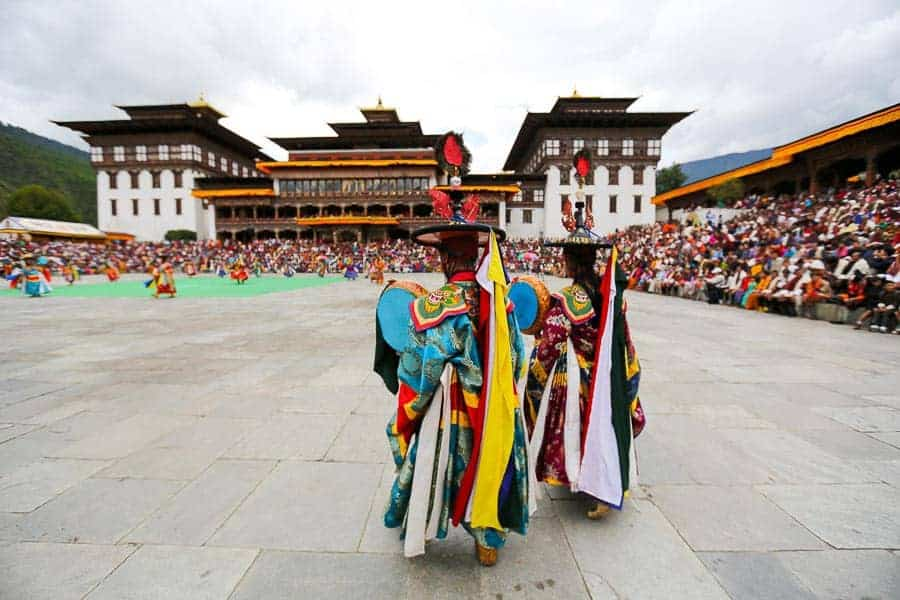 Local danscers at Thimphu Tshechu. Top 10 Things to do in Bhutan.10 Things To Do In Bhutan.