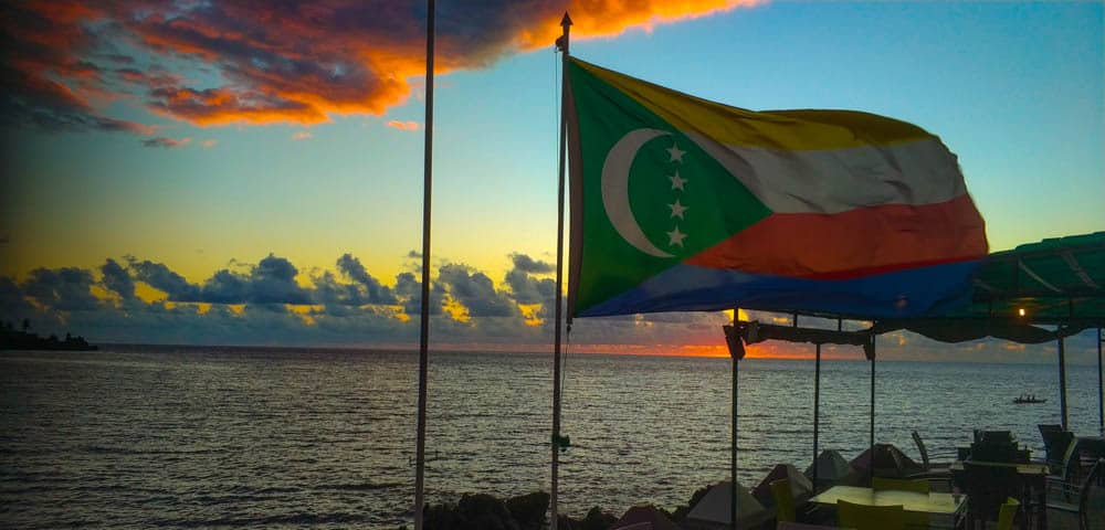 Sunset with the flag of Comoros