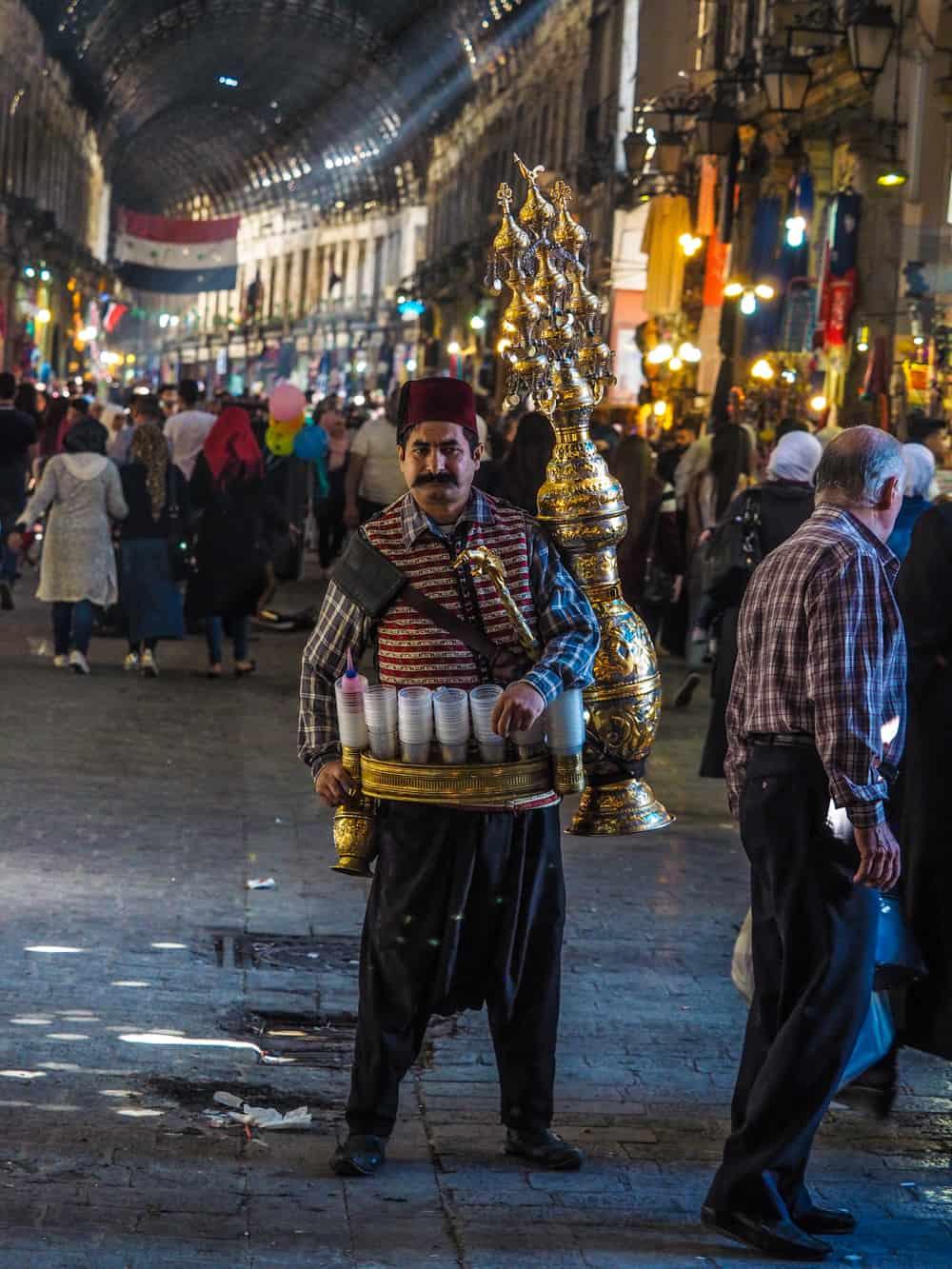a juice sells men in Damascus bazar