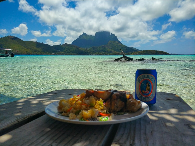 enjoying a beer and lunch in Bora bora in french polynesia
