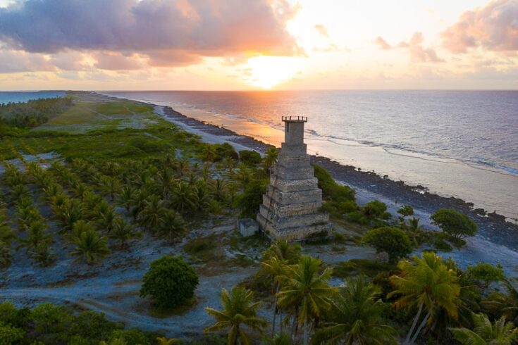 Topaka Lighthouse during sunset, the airport is in the background fakarava
