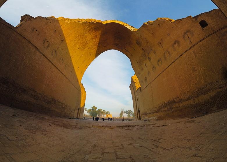 standing under the arch of Taq Kasra in Iraq