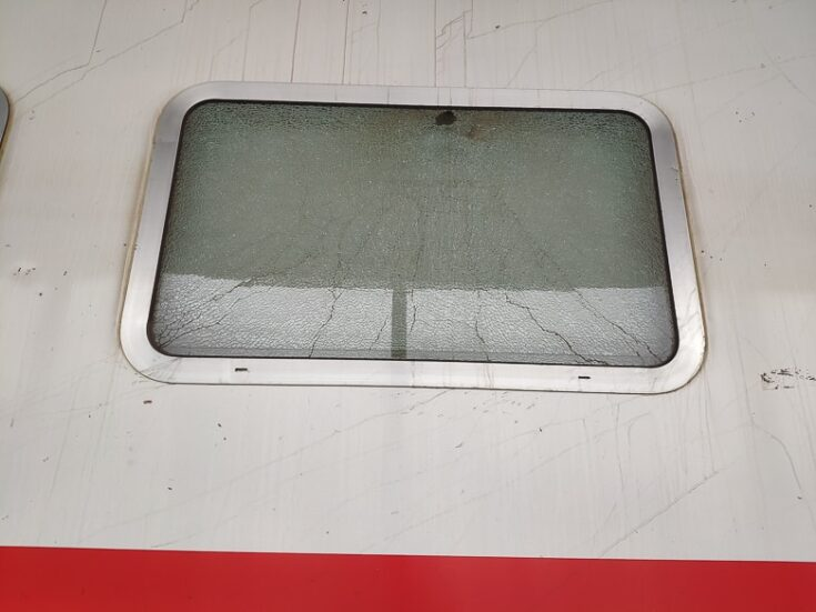 Most of all the windows on the train is cracked Iraq train