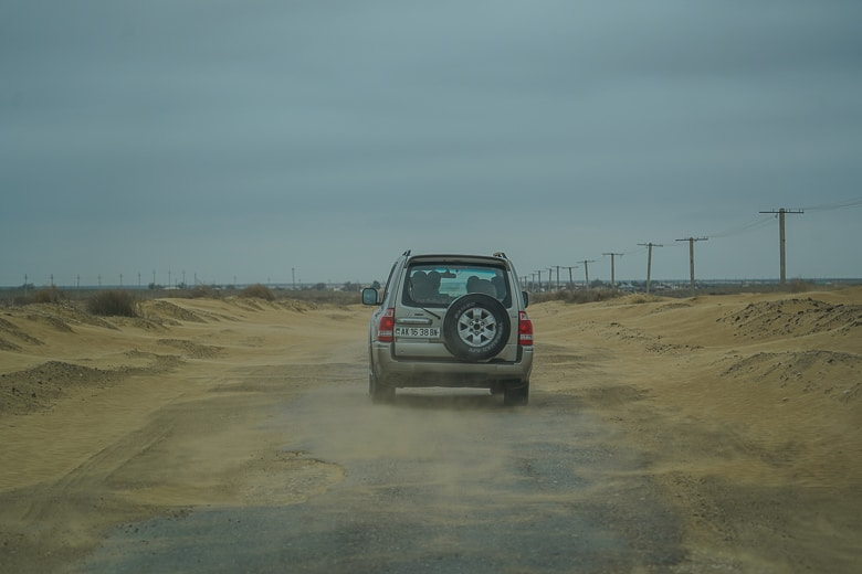 Windy with sand blowing around on the way to Yangykala Canyon in western Turkmenistan