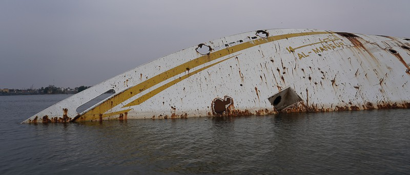the wreck of Al Mansur, Saddam Hussein's private yachts lays now in the middle of the Shatt al-Arab river