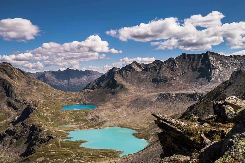 The stunning turquoise blue lakes on the loop around the Joeriseen in Switzerland