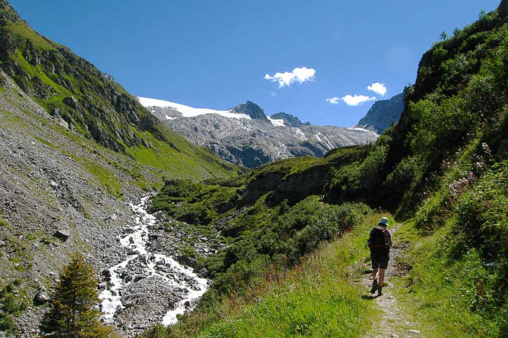 The long slow climb to the Medelser Hut, with a glacier in the background in Switzerland