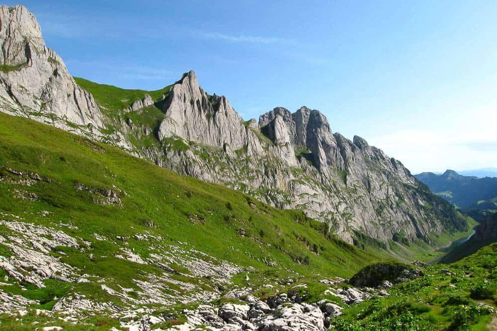 Hiking up to the Zwinglipass on limestone rocks in Switzerland