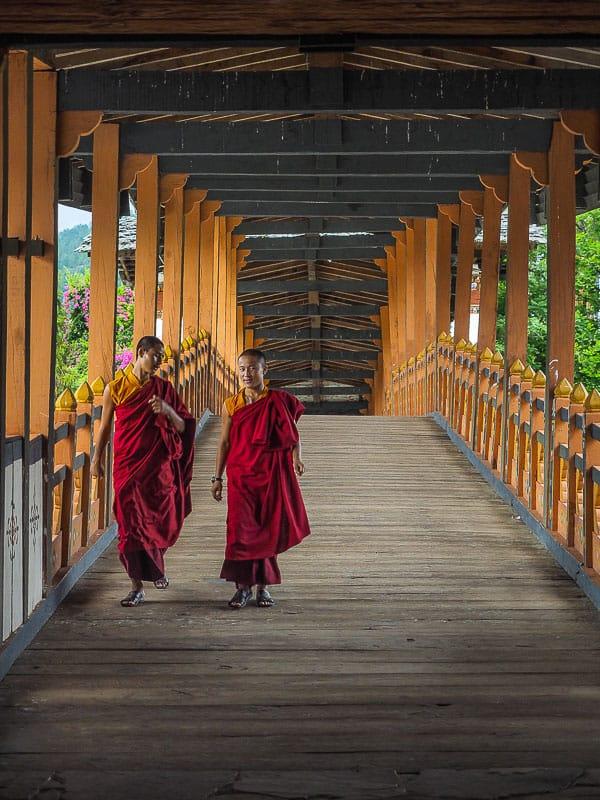 Bhutan monks on bridge