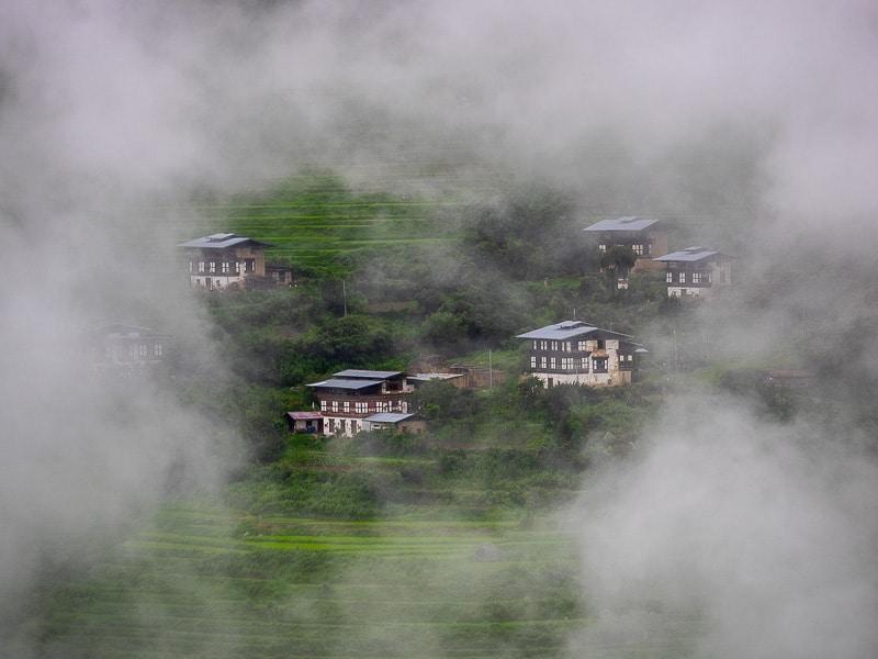 Bhutan small village hidden in the mist