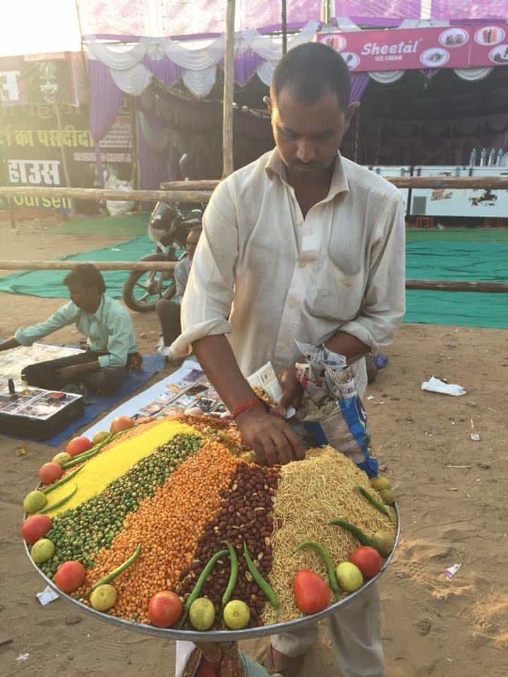 Man selling bhel puri an Indian snack